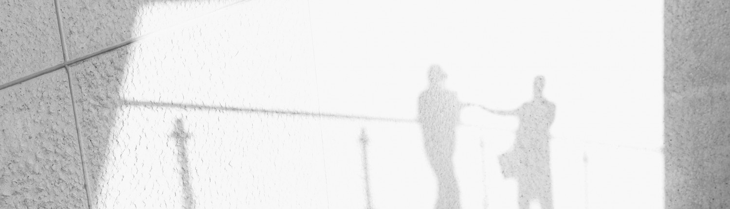 Shadows of businesspeople on a wall